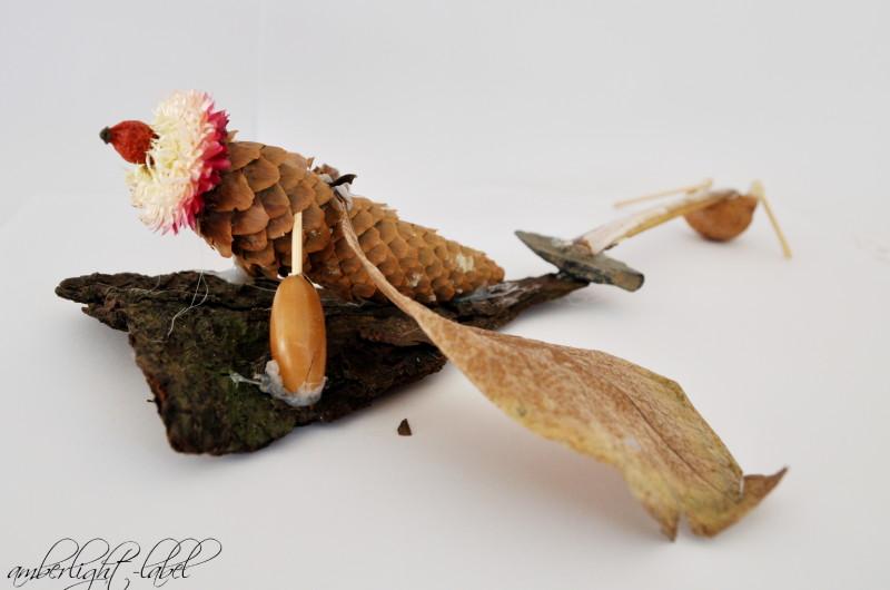 Basteln mit Tannenzapfen und Nuss-Schalen: Flugwurm