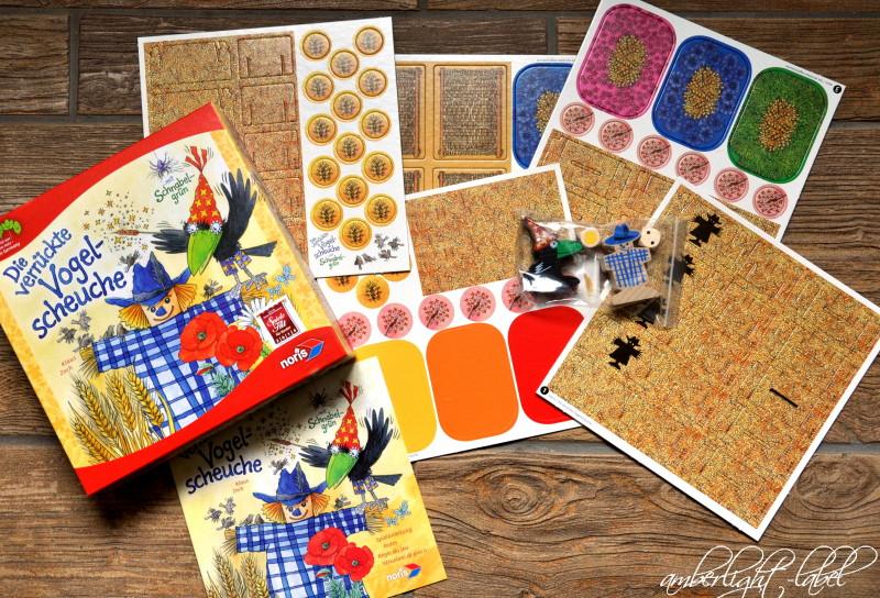 Spiel(zeug)rezension: Noris Spiele – Die verrückte Vogelscheuche, Legespiel